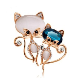 Brooch with two crystal foxes