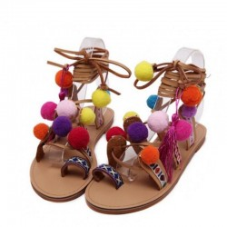 Suede sandals with pompons - leather laces